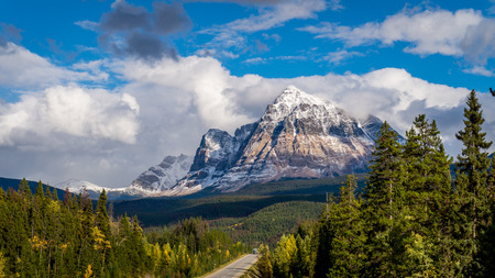 upper half: Mount Fitzwilliam is part of the Canadian Rockies in British Columbia. The lower half being dolomite and the upper half quartzite covered with lichen which gives it a very dark gray color Stock Photo