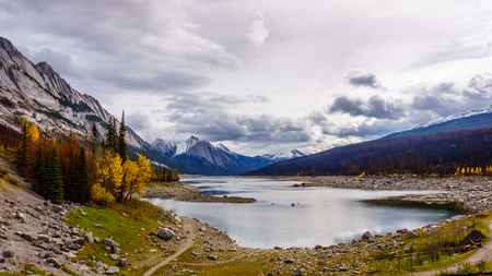 refills: Medicine Lake in Jasper National Park. The lake drains underground into the Maligne River every fall and refills again in spring from fresh melting snow. Results of 2015 Forest Fire visible Stock Photo