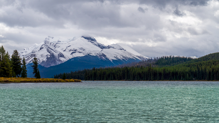 icefield: Maligne Lake in Jasper National Park in Canada with Mount Charlton in the Background on a cold and windy September day Stock Photo