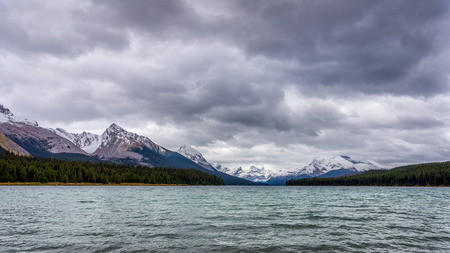 leah: Maligne Lake in Jasper National Park in Canada with Leah Peak and Samson Peak in the Background on a cold and windy September day Stock Photo