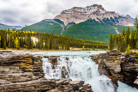Athabasca Falls and Mount Kerkeslin in Jasper National Park in the Canadian Rockies