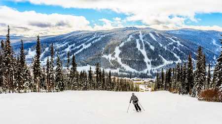 Skiing down to the village of Sun Peaks in the Shuswap Highlands of central British Columbia, Canada