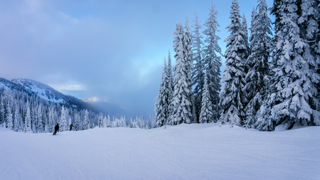Clouds moving in on the ski hills of Sun Peaks in the Shuswaps Highlands in central British Columbia, Canada Stock Photo