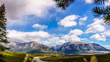 canmore: The town of Canmore in the Canadian Rockies with Grotto Mountain and Mount Lady MacDonald in the Background Stock Photo