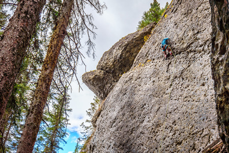 Climbers practicing their rock climbing skills on the Steep Rock Walls of the mountains at the Grassi Lakes near Canmore in the Canadian Rockies