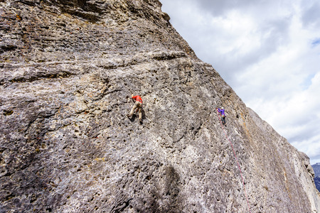 canmore: Climbers practicing their rock climbing skills on the Steep Rock Walls of the mountains at the Grassi Lakes near Canmore in the Canadian Rockies