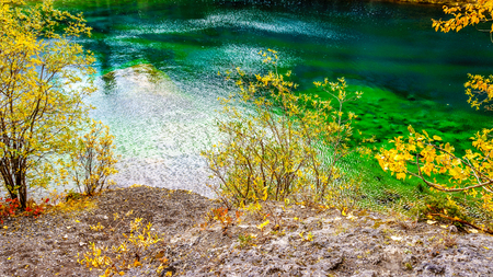canmore: The green color of one of the Grassi Lakes near the town of Canmore in the Candian Rocky Mountains
