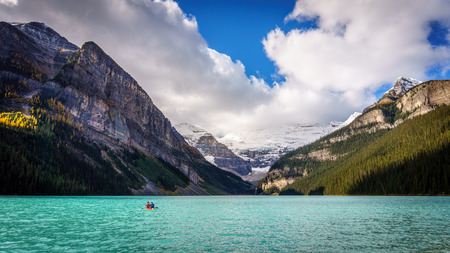 louise: Lone canoers on Lake Louise with Mount Victoria in the Background in Banff national Park in the Rocky Mountains in Canada