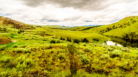 The Rolling Hills and Grasslands in the Nicola Valley near Merritt British Columbia, Canada Stock Photo