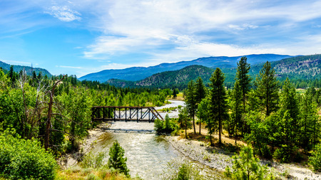 rapid steel: Steel Truss Bridge over Nicola River as it flows from the town of Merritt to the Fraser River at Spences Bridge in British Columbia, Canada