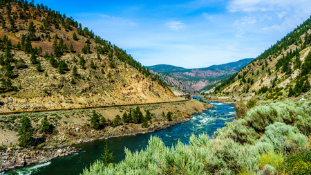 fraser: Railway and Trans Canada Highway following the Thompson River in the Fraser Canyon in British Columbia Stock Photo