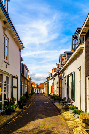 Typical Narrow Street in a Dutch Village like this one in the Historic Town of Harderwijk in the Netherlands