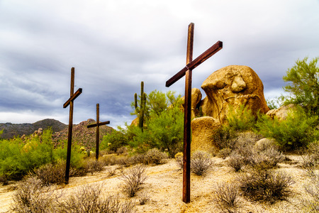 Three Crosses on a Hillside and near Boulders in the desert near Carefree Arizona Stock Photo