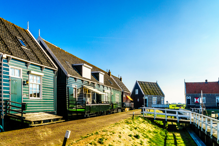 Traditional houses along the harbor of the small fishing village of Marken in the Netherlands Stock Photo