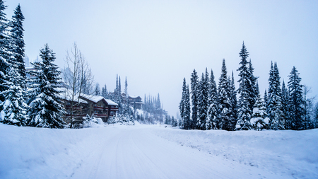 Deep snow pack covering houses and roads of the alpine village of Sun Peaks in the Shuswap Highlands of central British Columbia, Canada Stock Photo