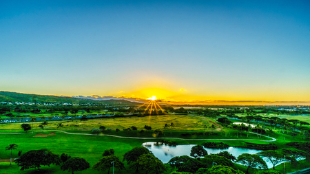 Sunrise over the horizon at the resort community of Ko Olina on the island of Oahu in the island state of Hawaii