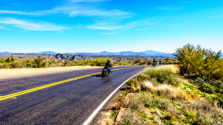 Motor bikes navigating the curves of the Bartlett Dam Road in Tonto National Forest near Phoenix in Maricopa County in the USA