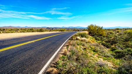 sates: The Bartlett Dam Road as it winds through the semi desert landscape of Tonto National Forest in Arizona, United States Stock Photo