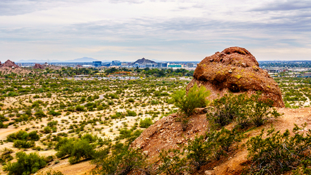 sates: The city of Phoenix in the valley of the Sun seen from the Red Sandstone Buttes in Papago Park in Arizona, USA