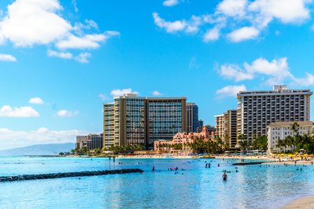 Waikiki Beach, with its many resorts under blue sky and white sand, makes it one of the worlds most famous beaches. Located in Honolulu on the Hawaiian island of Oahu