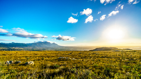 Sunrise over the Western Cape with Cape Town and Table Mountain viewed from the Ou Kaapse Weg, Old Cape Road, on a clear winter morning