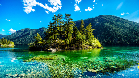 dive trip: Small island in the middle of the crystal clear waters of Pavilion Lake in Marble Canyon Provincial Park, British Columbia. The lake has international fame because of freshwater microbialites Stock Photo