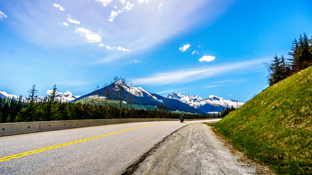 road bike: The Duffey Lake Road along the Coast Mountain Range between Pemberton and Lillooet in southern British Columbia
