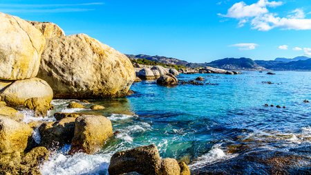 Large granite boulders at Boulders Beach, a popular nature reserve and home to a colony of African Penguins, in the village of Simons Town in the Cape Peninsula of South Africa Stock Photo