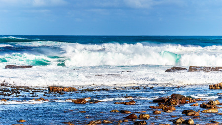 Waves of the Atlantic Ocean breaking on the rocky shores of Cape of Good Hope in Cape Point Nature Reserve on the Cape Peninsula in South Africa Zdjęcie Seryjne