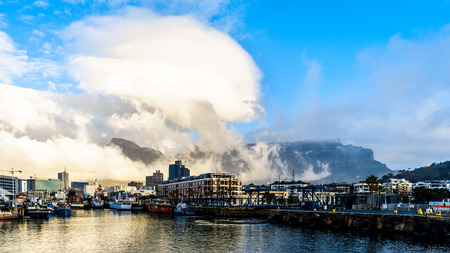 antiwar: Clouds over Devils Peak and Table Mountain as seen from the Victoria and Albert Waterfront in Cape Town South Africa Stock Photo