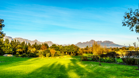 Simonsberg and the Hottentots-Holland Mountain range surrounding the vineyards in the wine region of Stellenbosch in the Western Cape of South Africa
