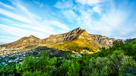 View of Cape Town, Table Mountain, Devils Peak and the Twelve Apostles from the hiking trail to the top of Lions Head mountain near Cape Town South Africa on a nice winter day Stock Photo