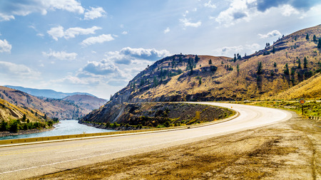 The Trans Canada Highway winding through the mountains and along the Thompson River between the towns of Cache Creek and Spences Bridge in central British Columbia Stock Photo