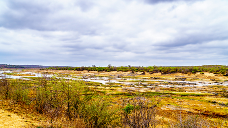 The almost dry Olifant River and drought stricken land in Kruger National Park in South Africa