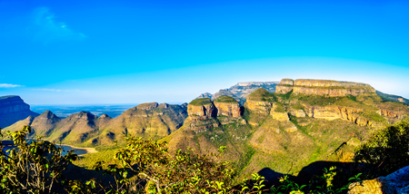 Panorama view of a Sunset over Blyde Caniyon Dam and the three Rondavels of Blyde River Canyon Nature Reserve on the Panorama Route in Mpumalanga Province of South Africa