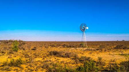 Steel Windpump in the semi desert Karoo region in South Africa Stok Fotoğraf