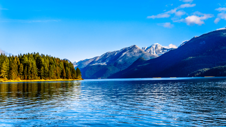 Pitt Lake with the Snow Capped Peaks of the Golden Ears, Tingle Peak and other Mountain Peaks of the surrounding Coast Mountain Range in the Fraser Valley of British Columbia, Canada