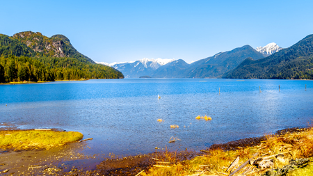 Pitt Lake with the Snow Capped Peaks of the Golden Ears, Tingle Peak and other Mountain Peaks of the Coast Mountain Range in the Fraser Valley of British Columbia, Canada Stock Photo