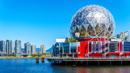 East End of False Creek Inlet with the globe shaped Science Centre in Vancouver British Columbia under clear blue sky