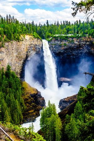 Large snow melt in the Cariboo Mountains creates spectacular water flow of Helmcken Falls on the Murtle River in Wells Gray Provincial Park near the town of Clearwater, British Columbia, Canada