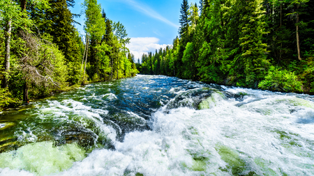Massive water flow during the spring runoff in the Murtle River, due to melting of the deep snow pack in the Cariboo Mountains of Wells Gray Provincial Park, British Columbia, Canada