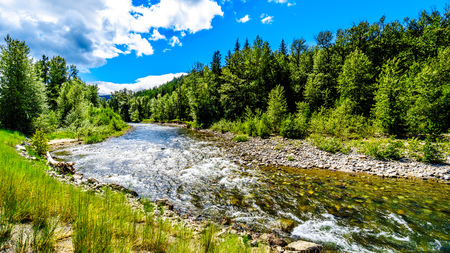 The fast flowing water of the Coldwater River near the intersection between the Coldwater Road and the Coquihalla Highway between Hope and Merritt in British Columbia, Canada