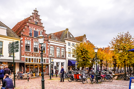Elburg, the Netherlands - Oct. 25, 2014: The main square and popular shopping street in the center of the historic Dutch fishing village of Elburg in the heart of Holland
