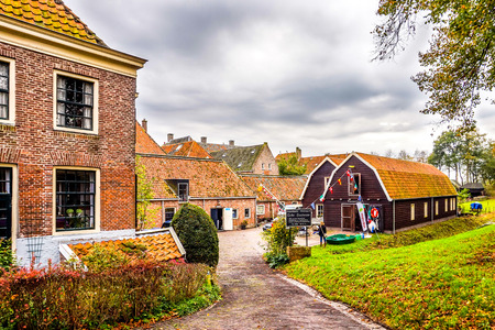 Elburg, the Netherlands - Oct. 25, 2014: Historic Brick Houses in 14th century Dutch fishing village of Elburg in the heart of the Netherlands