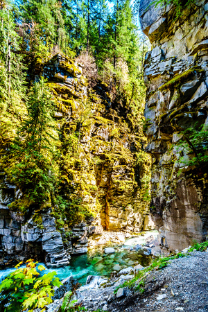 The Coquihalla River as it flows through Coquihalla Canyon Provincial Park and past the Othello Tunnels of the old Kettle Valley Railway near the town of Hope, British Columbia, Canada Фото со стока