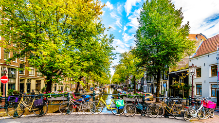 Amsterdam, the Netherlands - Sept 28, 2018: Bikes on the Hilletjesbrug over the Elegantiersgracht canal in the historic Jordaan district in the old center of Amsterdam