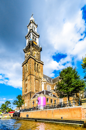 Amsterdam, the Netherlands - Sept 28, 2018: Tower of the Historic Westerkerk in Amsterdam near the Anne Frank House at the Prinsengracht (Prince Canal) in the Jordaan neighborhood of Amsterdam