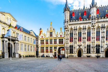 Historic buildings of the Town Hall, and the old Civil Registrar of the Brugse Vrije in the center, on Burg Square in the heart of medieval Bruges, Belgium
