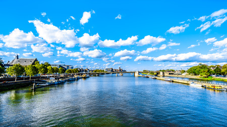 The Meuse River as it flows through the historic city of Maastricht in the Netherlands. Viewed from the Sint Servaasbrug