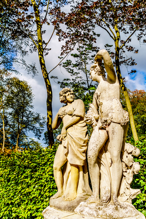 Haarzuilens, Utrecht/the Netherlands - Oct. 1, 2018: Statues in the beautiful manicured Gardens surrounding historic Castle De Haar. A 14th century Castle completely restored in the late 19th century